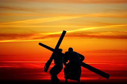 Dragging a wooden cross