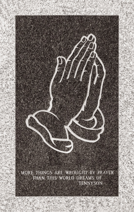 Tennyson quote and hands icon on mausoleum wall