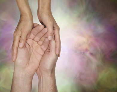 Let me look after you - female hands cupped gently around male hands on a subtle wispy effect background with copy space on right
